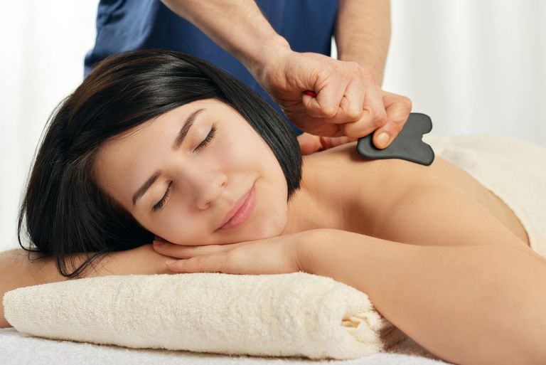 woman receiving a gua sha massage