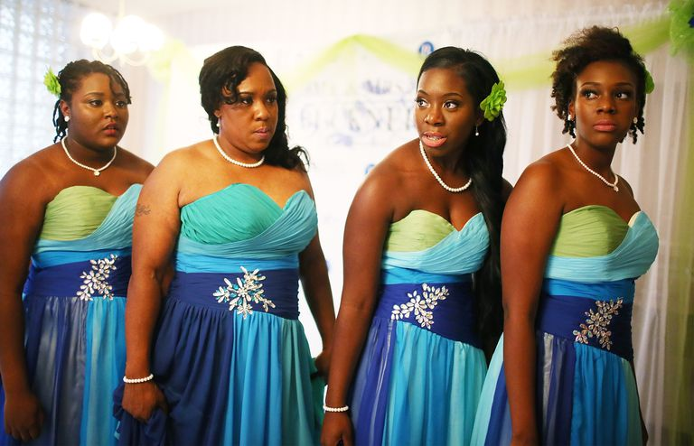 Women wearing bridesmaid dresses