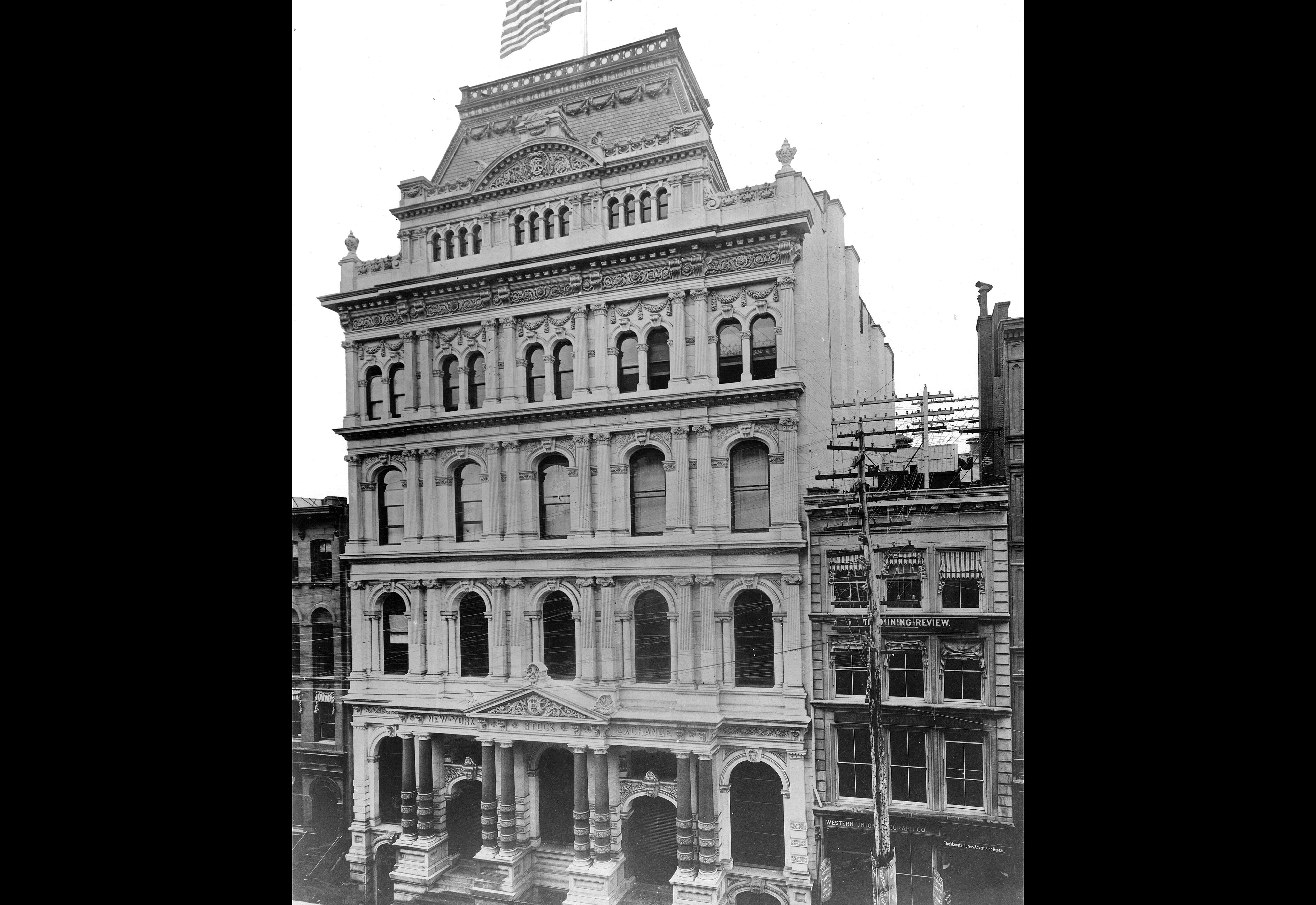 This photo circa 1895 shows the Second Empire architecture of the New York Stock Exchange (NYSE) that stood on the Broad Street site between December 1865 and May 1901