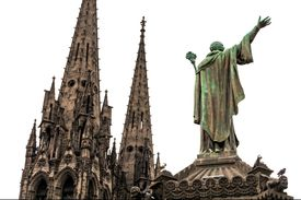 Statue of Pope Urban II overlooking the towers of the Gothic Cathedral of Our Lady of the Assumption in France