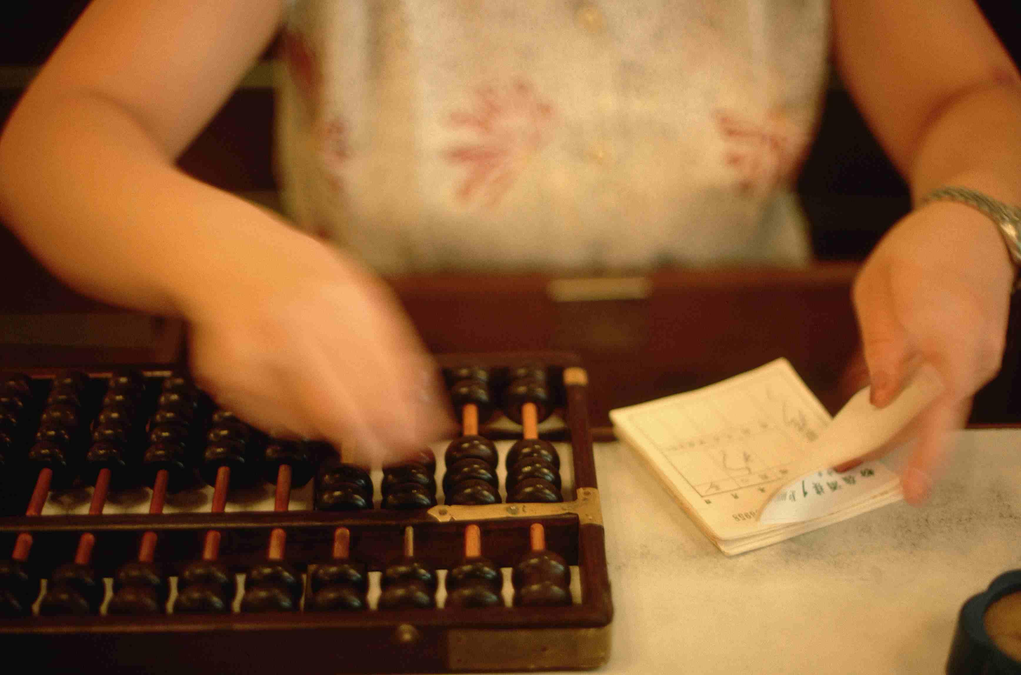 Hong Kong Woman Uses Abacus