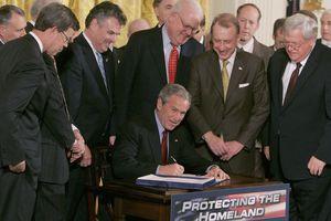 George W. Bush signs Patriot Act amongst peers
