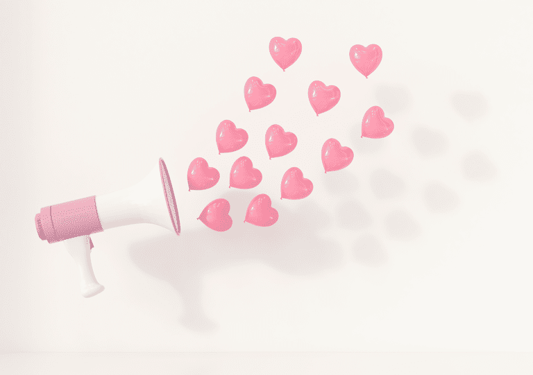 Megaphone with pink heart balloons