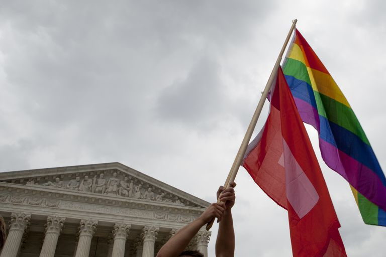 a flag waves in front of the Supreme Court