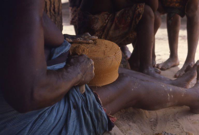 Woman making pottery in Kpeyi, Liberia