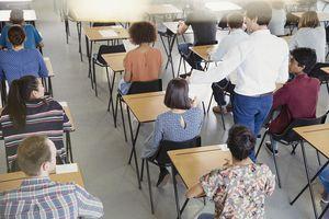Teacher collecting homework.