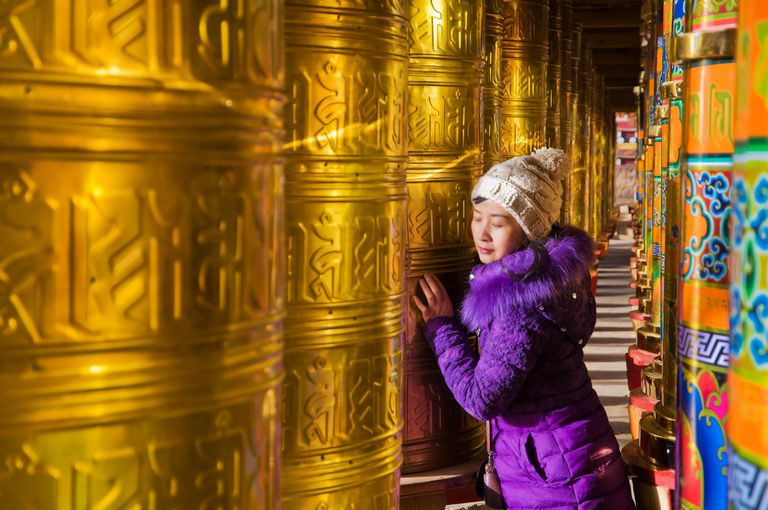 prayer-wheels-young-woman.jpg