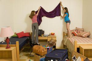 College roommates decorating room