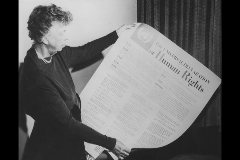 Eleanor Roosevelt with a print of the Universal Declaration of Human Rights