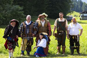 six people in costumes at German festival