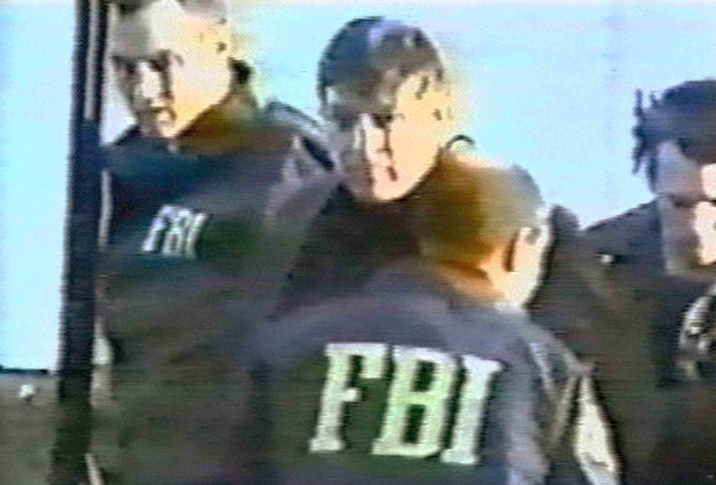 photo of FBI agent Robert Hanssen moments after being arrested