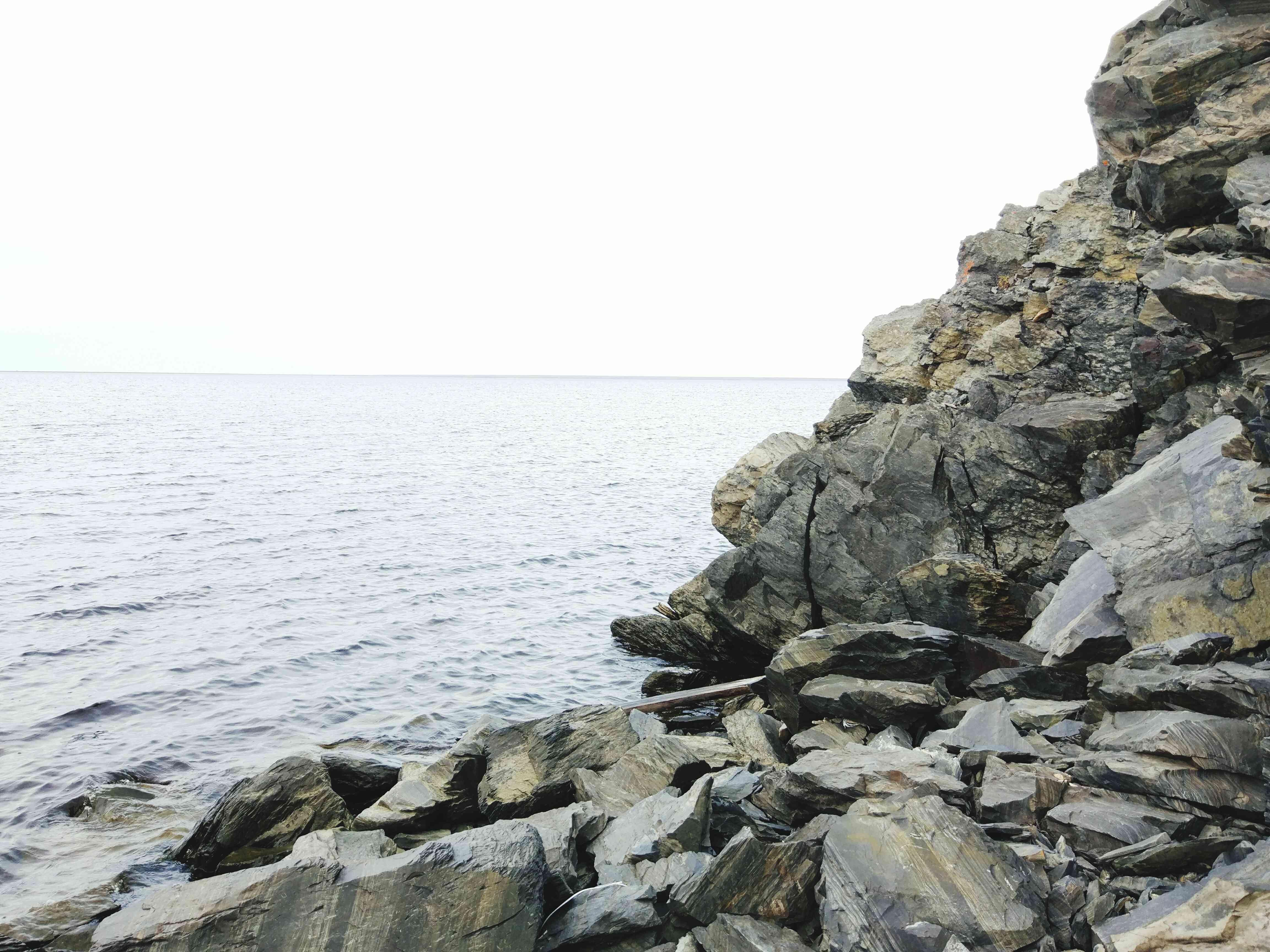 Rocky Shore By Sea Against Sky near Tiksi, Russia