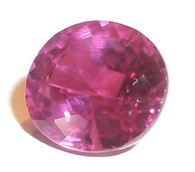 1.41-carat faceted oval ruby.