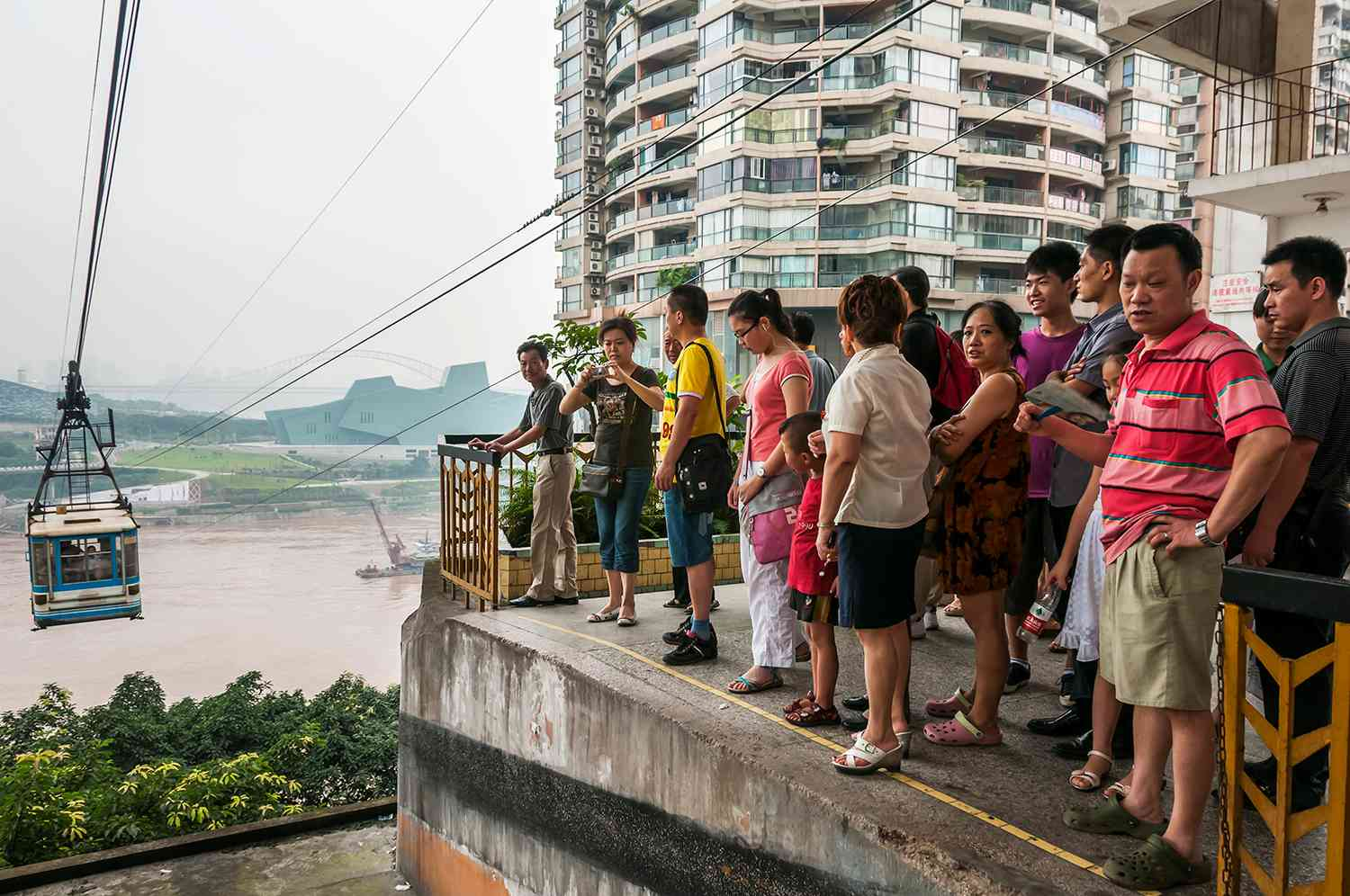 Passengers waiting for the cable car for crossing Yangtze river