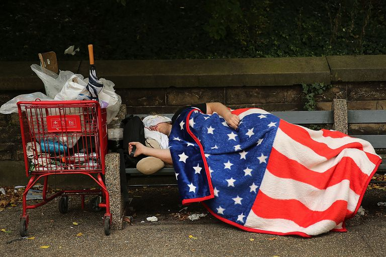 Homeless man American flag blanket