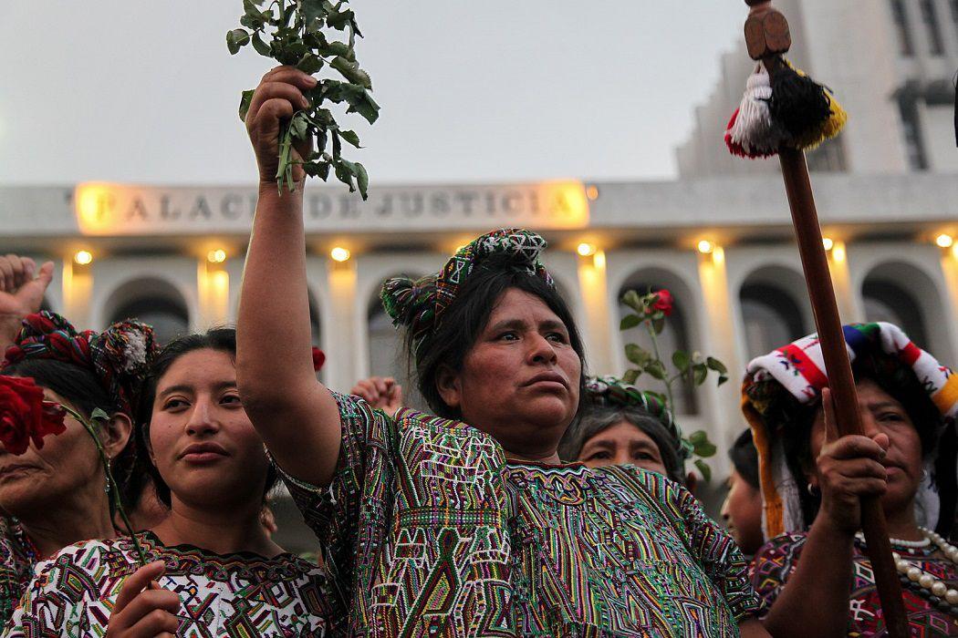 Ixil women holding roses.