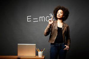 woman writing theory of relativity