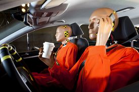 crash test dummies in a car before the crash