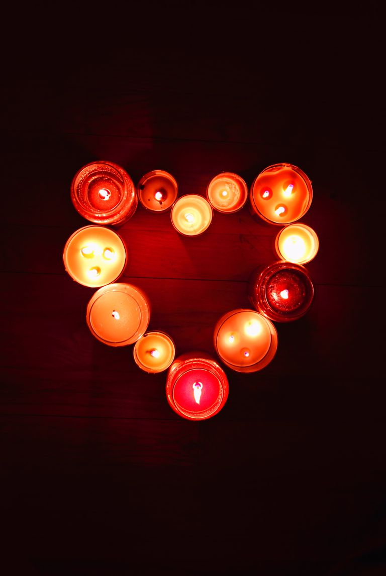 Candles arranged in the shape of a heart.
