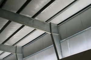 Steel girders for a roof system made with steel alloying agents