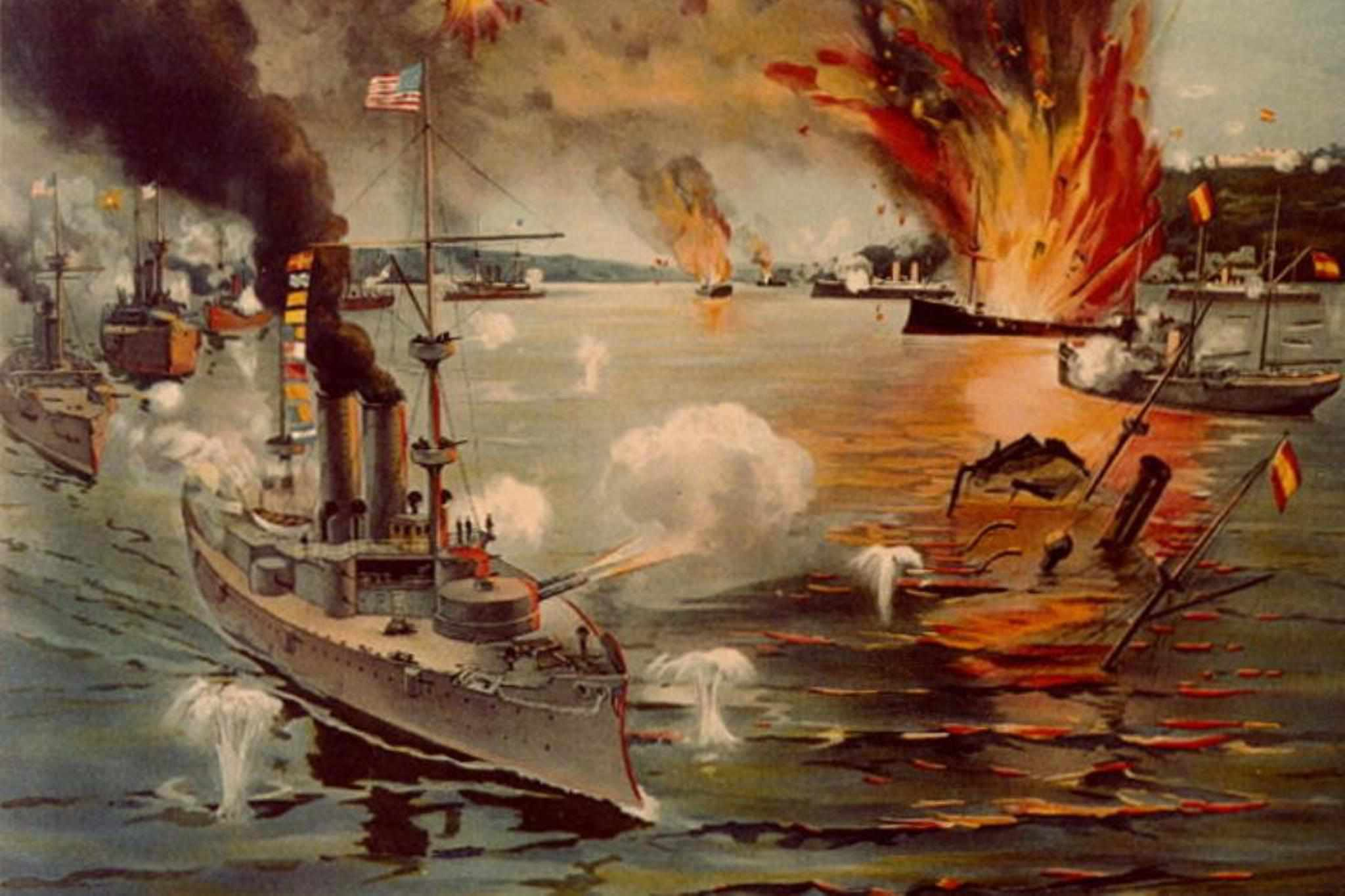 American warships firing at the Spanish during the Battle of Manila Bay.