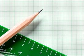 High Angle View Of Pencil With Graph Paper And Ruler