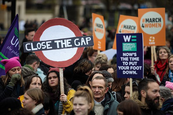 People carrying picket signs in the March4Women protest in London