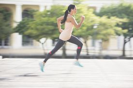 Woman running through the streets