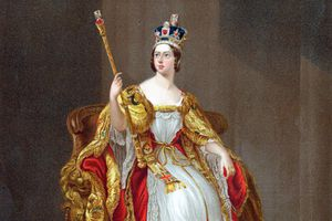 Queen Victoria on her jubilee, decked out in a crown and golden robes and bearing a scepter
