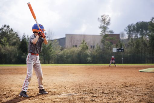 Boy at bat in baseball game