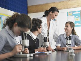 Students using a microscope in a science class.
