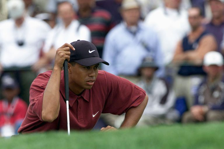 Tiger Woods lines up a putt on the first green during the final round of the 100th US Open at Pebble Beach on June 18, 2000