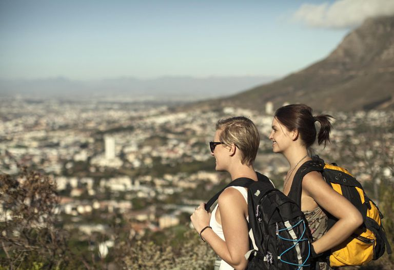 Two young women looking down from Table Mountain, Cape Town, South Africa