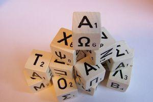 Greek letters in blocks on a pile