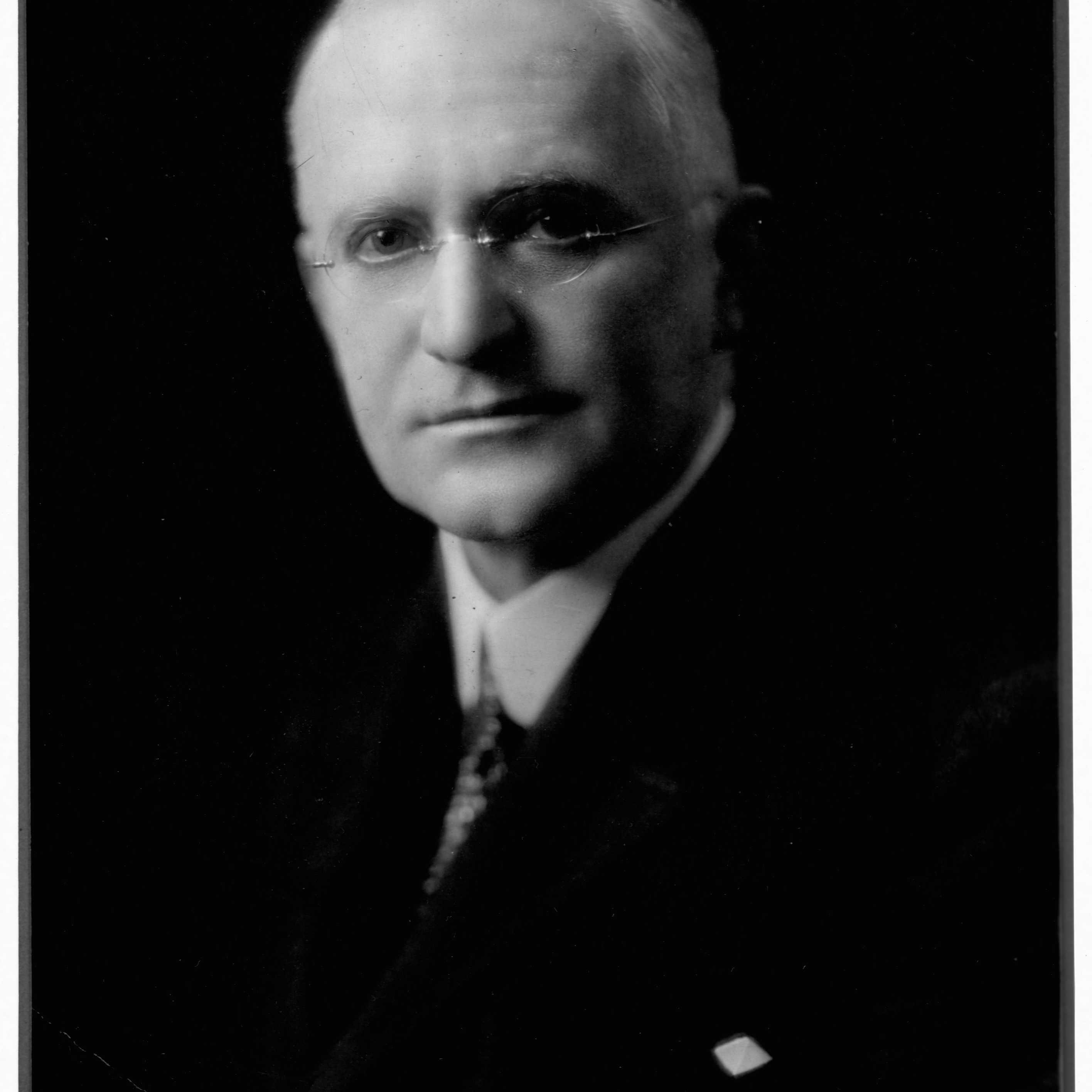 Inventor and industrialist George Eastman invented the Kodak box camera and introduced daylight-loading film.