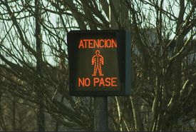 Sign that says in Spanish: Attention. Do not enter.