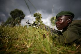 A Congolese army soldier lays on the ground at the front line, November 12, 2008 in the outskirts of the town of Goma, Democratic Republic of the Congo.