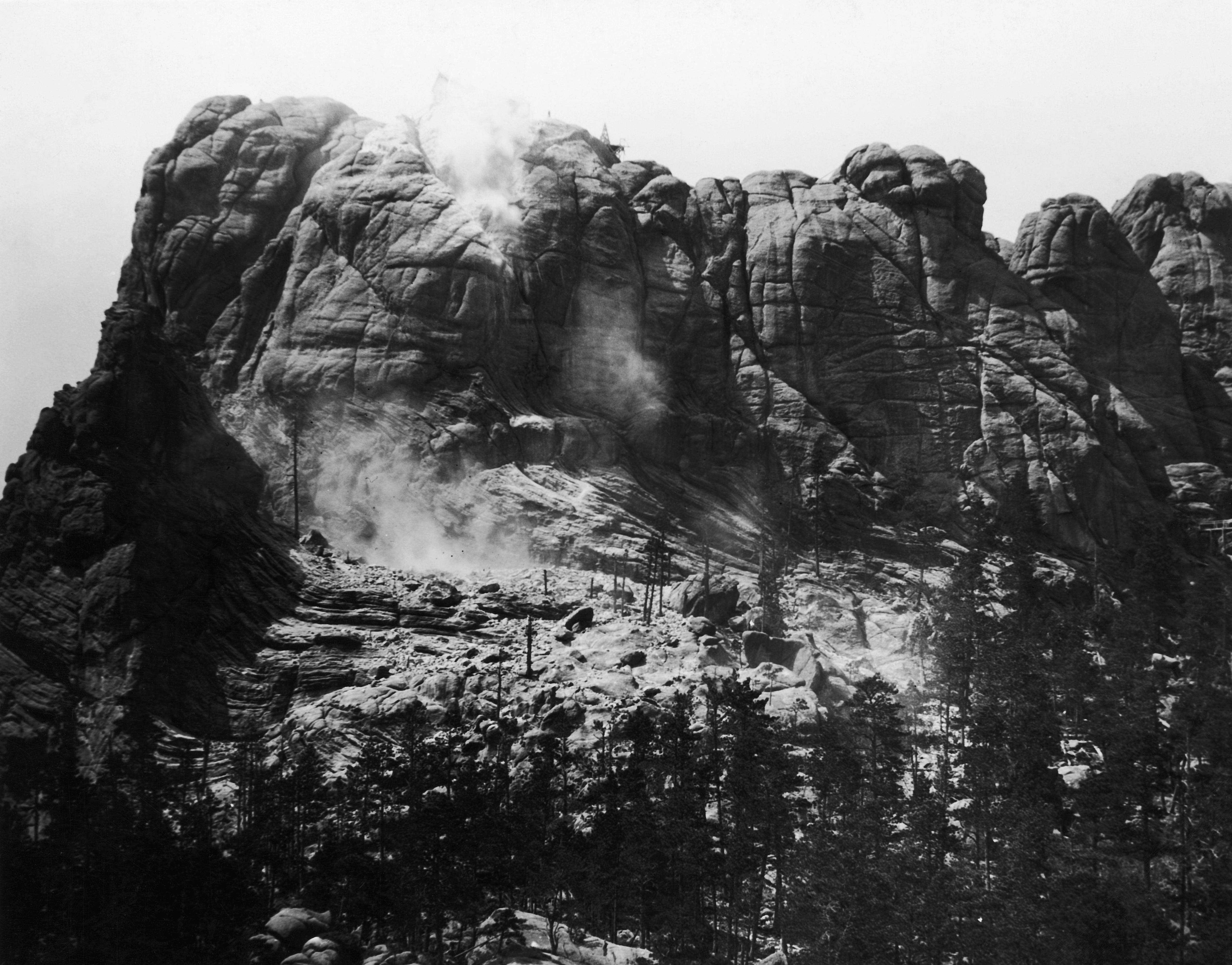 Mount Rushmore with carving just beginning.