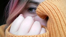 Close-Up Of Young Woman Covering Face With Hands