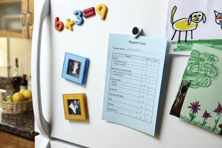 A child's report card on a refrigerator