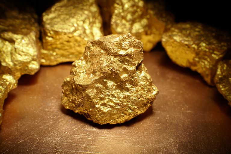 Closeup of large gold nugget.