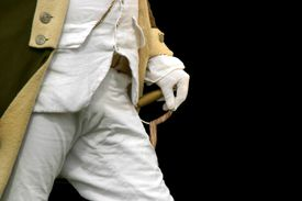 White gloved hand on sword hilt of colonial soldier