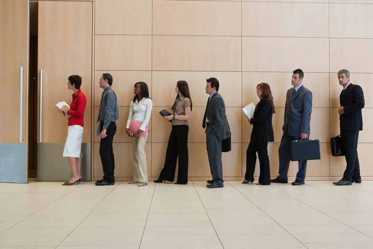 A picture of media job candidates in line