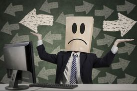 Business man with paper bag over head