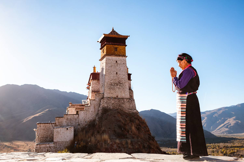Old tibetan woman in traditional dress, Tibet