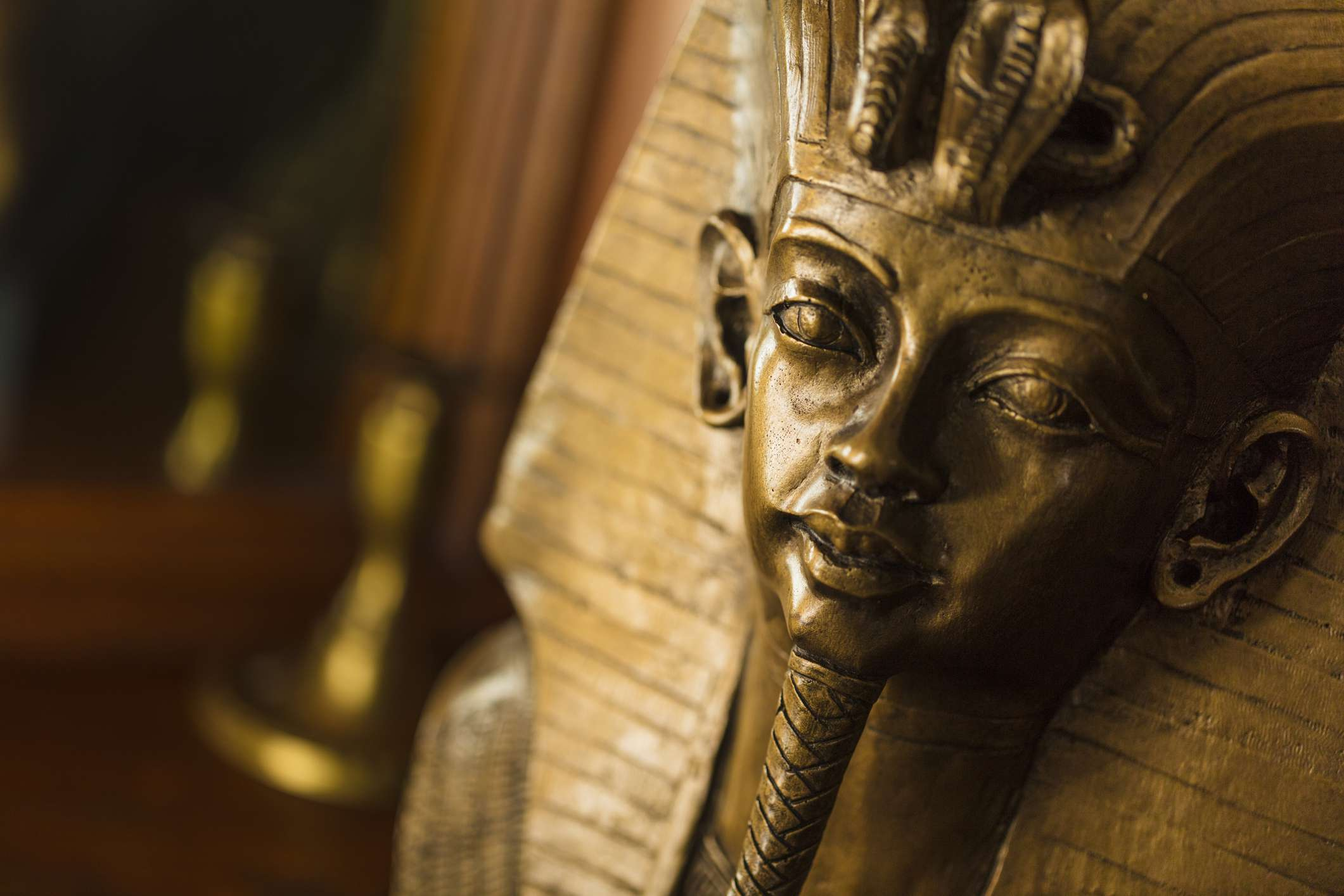 Bronze color bust of Egyptian King Tutankhamun made with plaster