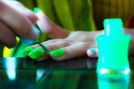 Bright green nail polish