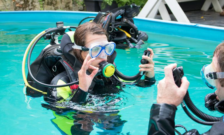Student scuba diver in swimming pool