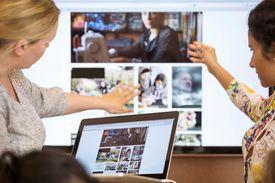 Two woman presenting web design