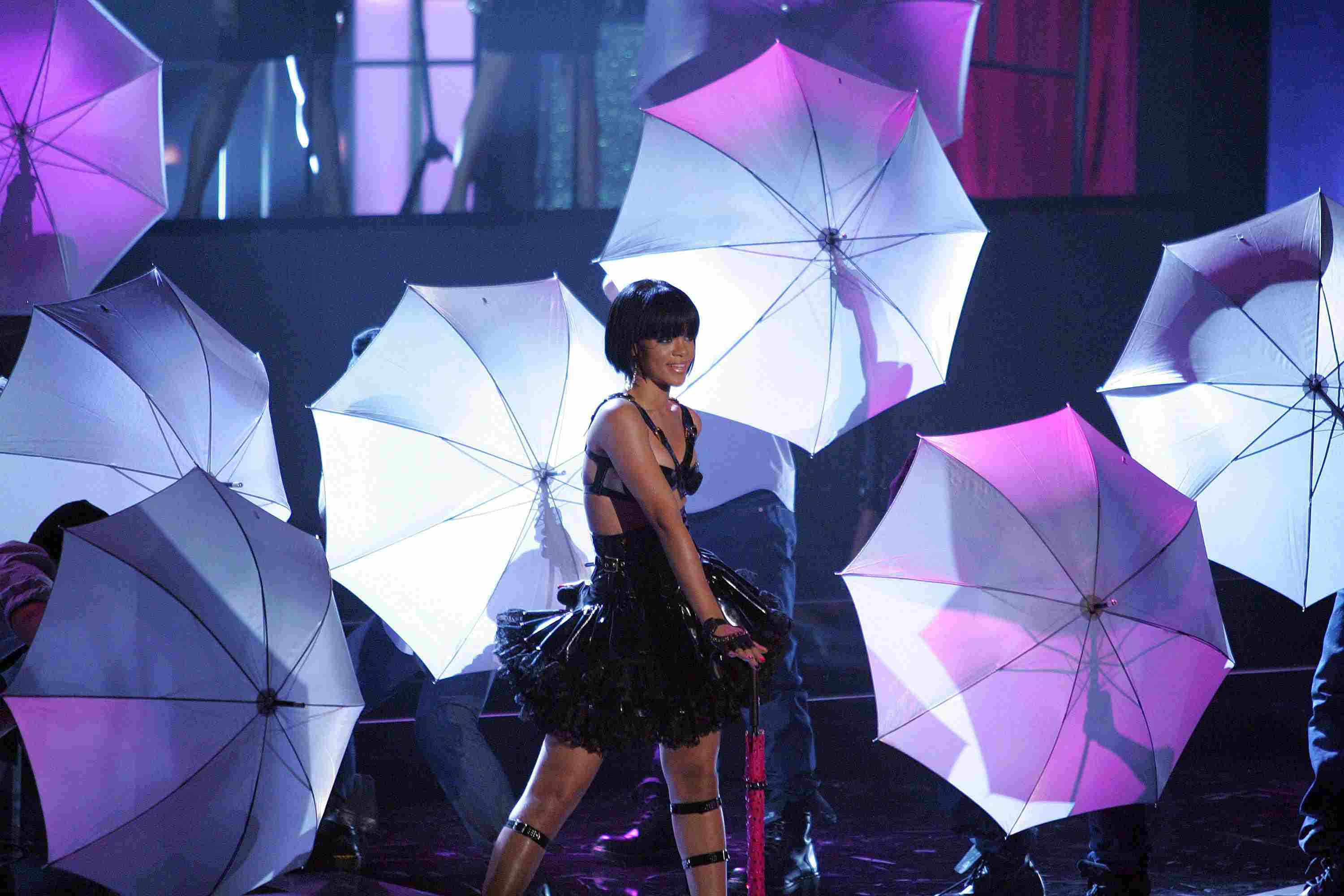 Rihanna Performing with Dancers Holding Umbrellas